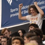 Senior Magnus Hagan cheers at the beginning of the assembly as everyone files into the stands. Photo by Luke Hoffman