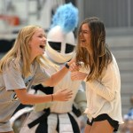 Seniors Meg Thoma and Lucy Hoffman compete in a jumping game during the pep assembly. Photo by Luke Hoffman