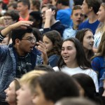Freshman Gerson Cardona yells and tries to hype up the rest of the freshman section. Photo by Luke Hoffman