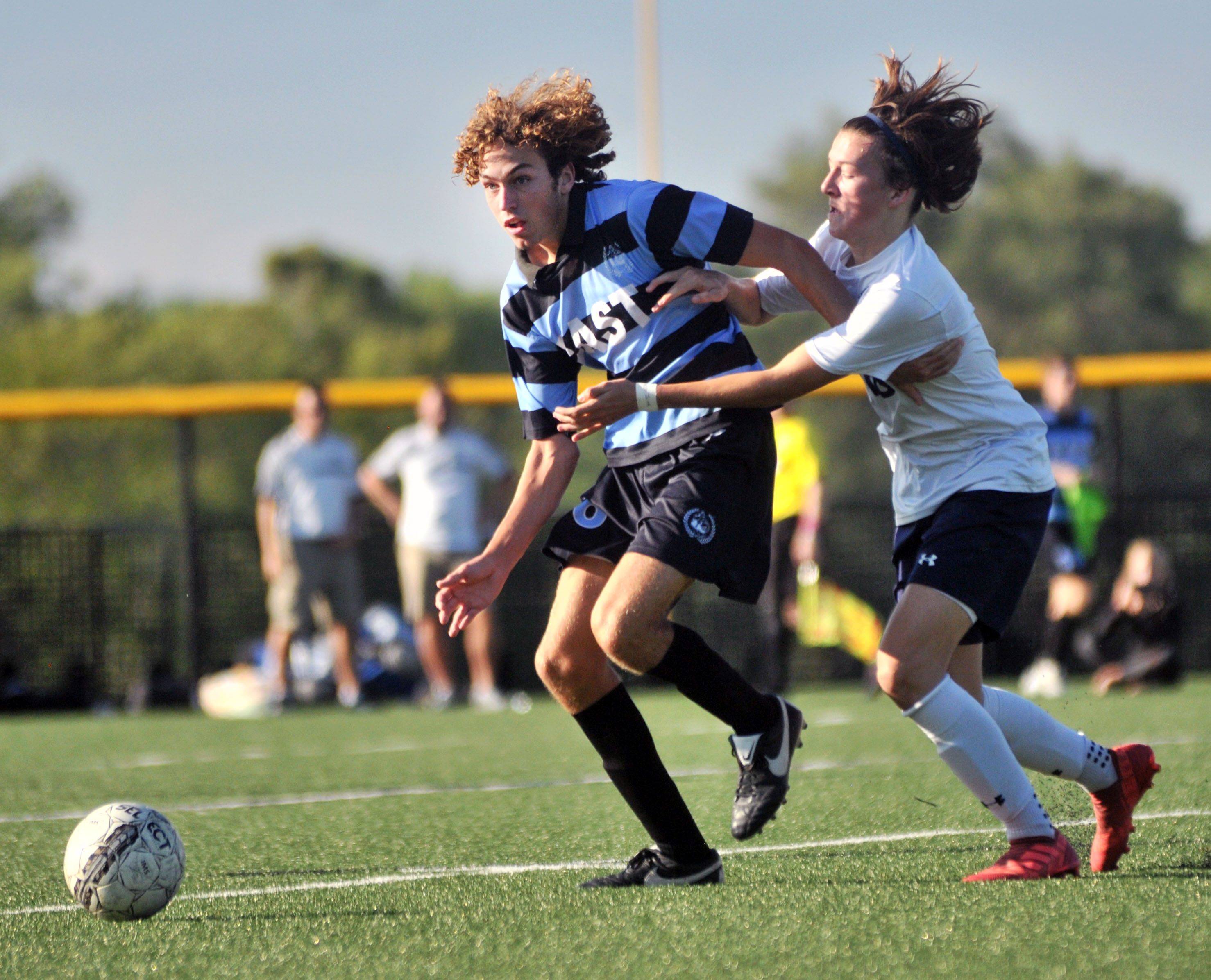 Junior Peter Kohring struggles with a Mill Valley player for the ball. Photo by Ally Griffith