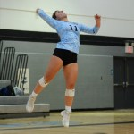 Senior Mallory Frank serves the ball. Photo by Megan Biles