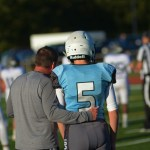 Freshman Tate Moody and Coach Hair plan out the next play. Photo by Austin Housley