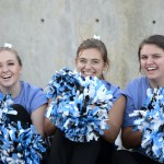 Seniors Holly Frigon, Lucy Crum, and Becca Heinz look on as the senior varsity football players are recognized. Photo by Luke Hoffman