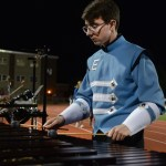 Senior Sam Sokoloff practices the xylophone before the half time show. Photo by Trevor Paulus