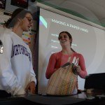 Juniors Pacey Salzman and Gretchen Raedle show the class how to make their paper hands. Photo by Ty Browning