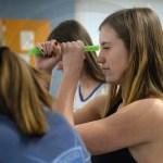 Junior Lauren Decker looks through some straws. Photo by Ty Browning