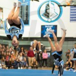Sophomore Grace Krieg flips in the air during the cheer performance. Photo by Annakate Dilks