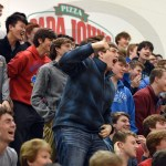 Junior Cole Fisher reacts as a member of the junior class begins to ride the mechanical bull. Photo by Luke Hoffman