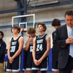 As a Catholic school, Rockhurst administration leads a prayer prior to the beginning of the game. Photo by Luke Hoffman