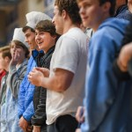 Senior David Murrell laughs at a Rockhurst student taunting the East student section. Photo by Lucy Morantz