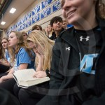 In between the JV and Varsity games, senior Amanda Anderson reads 'Harry Potter' in the stands. Photo by Lucy Morantz