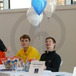 Senior Ryan Hess looks up at three balloons enthusiastically while sitting next to senior Andy Maddox. Photo by Annakate Dilks