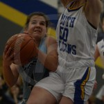 During the third quarter, sophomore Caroline Coleman attempts a layup. Photo by Noelle Griffin