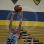 During the beginning of the third quarter, sophomore Hope Robinett shoots a layup. Photo by Noelle Griffin