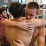 Sophomore Kaleb Hagg embraces senior Sebastian Bruck after the team's final race of the season. The Lancers claimed third place in the 6A State Swim and Dive meet. Photo by Luke Hoffman