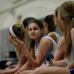 Freshman Hailey Ives talks with her teammates on the bench. Photo by Sarah Golder