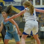 Sophomore Caroline Coleman dribbles the ball to the three point line to shoot the ball. Photo by Elle Karras