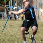 During his 4th attempt, junior Nate Jones throws his javelin down the grass field. Photo by Megan Biles