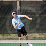 Sophomore Keaton Duckworth serves to his opponent during doubles. Photo by Megan Biles