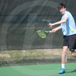 Sophomore Calvin Cattaneo hits the ball back to their opponents. Photo by Julia Percy