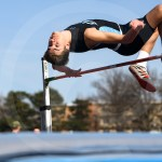 Senior Hale Reimer clears the bar on his third attempt in high jump. Reimer's best jump from the meet was 5 feet and 6 inches. Photo by Lucy Morantz