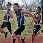 Sophomore Wen Clough hands off to senior Will Tulp for the third leg of the 4x100 relay photo by Ally Griffith