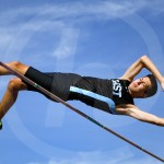 Senior Alec Schlote clears the bar in pole vault. Photo by Katherine McGinness