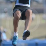 Sophomore Wen Clough jumps through the air and prepares to land in the long jump. Photo by Noelle Griffin