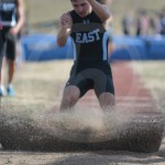 Senior Carson Jones makes the sand fly when finishing the long jump. Photo by Noelle Griffin