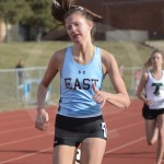 Junior Eleanor Hlobik races to the finish line, where she places first. Photo by Noelle Griffin