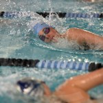 Senior Lucy Patterson swims against a Blue Valley swimmer in the 100 yard freestyle event. Photo by Aislinn Menke