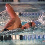 Freshman Anne Deedy swims in the 500 yard freestyle event. Photo by Aislinn Menke