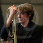Sophomore Aidan Torkelson struggles to fix his trombone. Photo by Dakota Zugelder