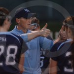 Coach Ehrich congratulates the team during a time out at the end of the second half. Photo by Noelle Griffin