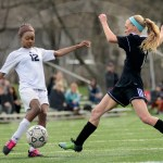 Sophomore Kim Schutzler strides towards the ball. Schutzler scored three out of the ten goals. Photo by Evelyn Roesner