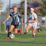 Junior Josephine McCray dribbles the ball around one of the ONW defenders. Photo by Taylor Keal