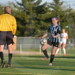 Sophomore Kourtney Koc knees the ball after being passed from one of her teammates. Photo by Taylor Keal