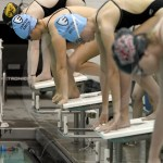 Freshman Ella Smith and sophomore Ella Miller prepare to start their 200 yard freestyle relay. Photo by Kate Nixon