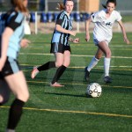 Sophomore Kourtney Koc watches for the ball as senior Taylor Fort passes it to her. Photo by Kate Nixon