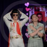 Sophomore Mazey Heim and Senior Luke Knopke go back and forth on stage about how dreamy Elvis is. Photo by Elle Karras