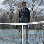 Sophomores Calvin Cattaneo and Keaton Duckworth talk with their doubles opponent before starting their game of the tournament. Photo by Taylor Keal