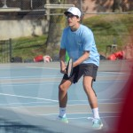 Freshman Max Patterson gets ready to hit the tennis ball back to the opponent. Photo by Elle Karras