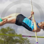 Sophomore Ella Vitt is competing in pole vaulting and makes it over. Photo by Elle Karras