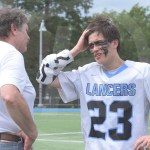 Senior Tyler Stottle talks to his coach after the game. Photo by Noelle Griffin
