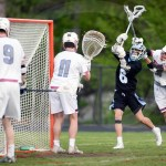 Sophomore Zeke Johnson tries to score against Pembroke players. Photo by Julia Percy