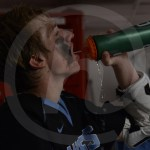 Sophomore Will Wynn squirts water into his mouth during halftime in the locker room. Photo by Noelle Griffin