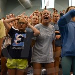East students and supporters cheer on the Lady Lancers in the last race of the meet. Photo by Sarah Golder
