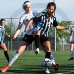 Junior Anna Parker protects the ball from her opponent. Photo by Trevor Paulus
