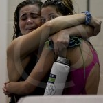 Senior Riley Kimmel hugs junior Anna Gunderman after they both finish the 100 yard backstroke. Kimmel placed in thirteenth with a finals time of 1:03.18 and Gunderman placed eighth with a finals time of 1:00.33. Photo by Kate Nixon