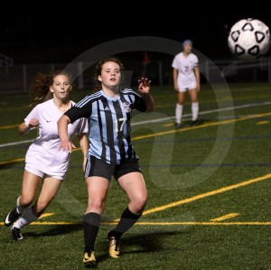 Junior Cate Nearmyer focuses on the ball before settling it. Photo by Kate Nixon